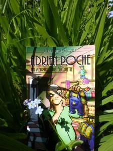 Adrien Poche dans l'herbe